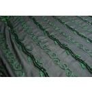 Graduated green floral leaf embroidery with black bugle bead on black organza