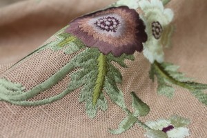 Floral Embroidered Linen in Plum and Pale Green on Tea Rose