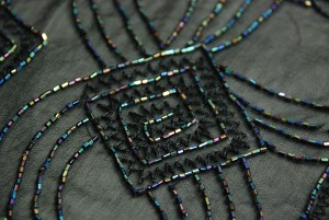 Black iridescent sequins and beads on chiffon