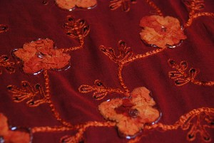 Red chiffon with orange floral embroidery, red hollographic sequins, plus gathered chiffon flowers with red bugle beading
