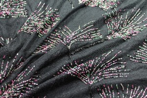 Black lace mesh with multi-coloured bugle beads in a starburst pattern