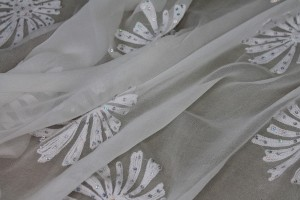 Ivory chiffon with large embroidered flowers and small round holographic sequins