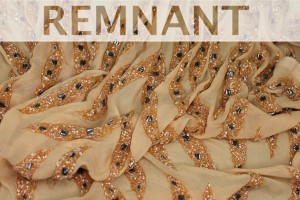 REMNANT - Pale orange chiffon with iridescent bugle beads and metallic geometric beads in a wave pattern - 1m piece