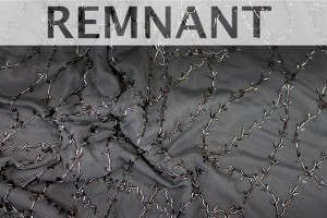 REMNANT - Black tulle with black bugle beads in a barbed wire/leaf pattern - 2.2m piece