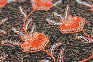 Black mesh with orange/silver embroidery, beading and round sequins in a floral pattern