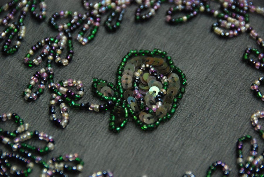 Black chiffon with flowers made from purple black green and clear round beads