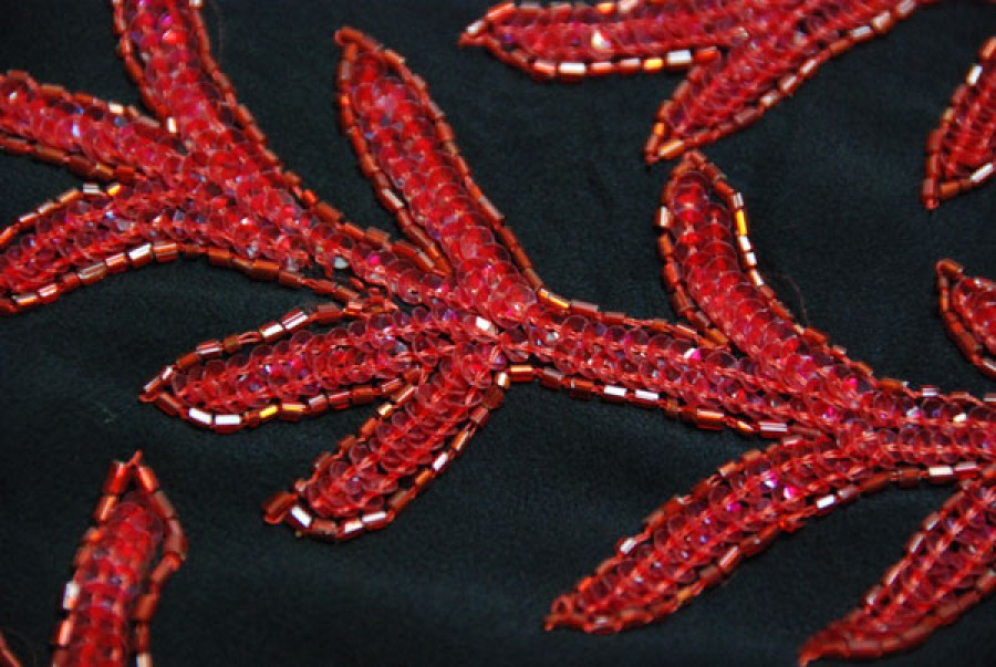 Black chiffon with red bugle beads and round plastic sequins in a leaf pattern
