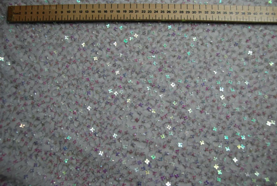 White tulle with silver metallic thread, clear bugle beads and iridescent pink/green flower shaped sequins
