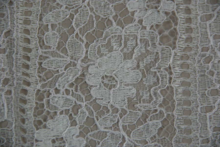 Ivory Leavers lace with light cording and geometric floral pattern