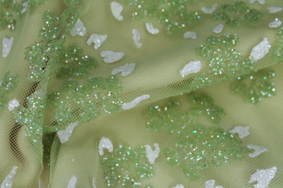 Photographed on a pale green fabric