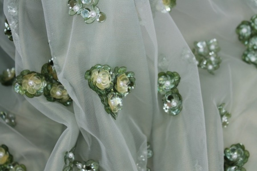 Photographed on a pale green background fabric