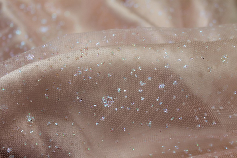 Photographed on a pale pink silk satin