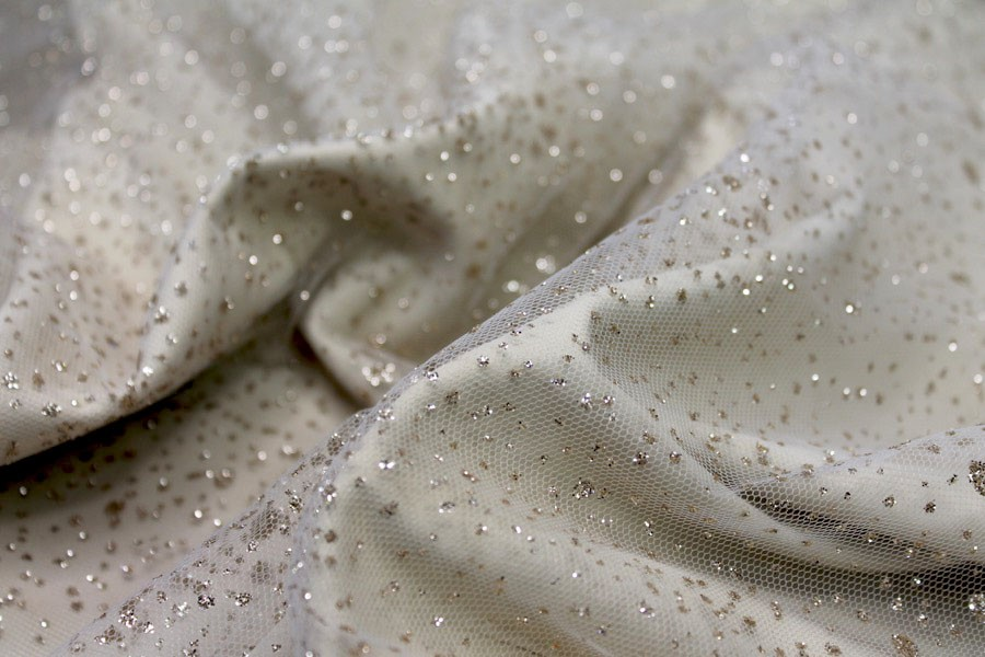 Photographed on a cream fabric